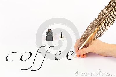 Hand writing the word COFFEE with a feather