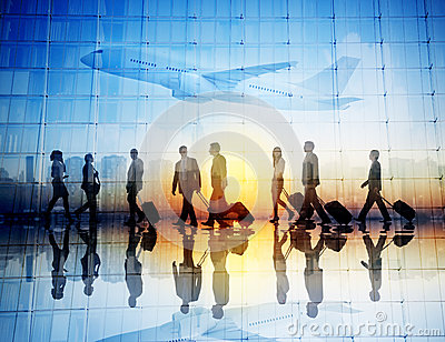 Group of Business Travelers Walking in an Airport