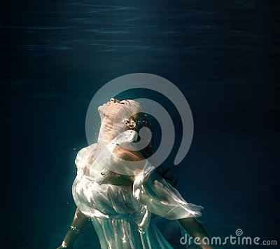 Underwater girl in swimming pool