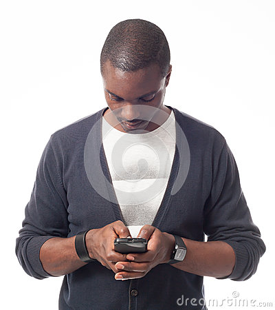 Casual dressed black man looking his mobile phone.