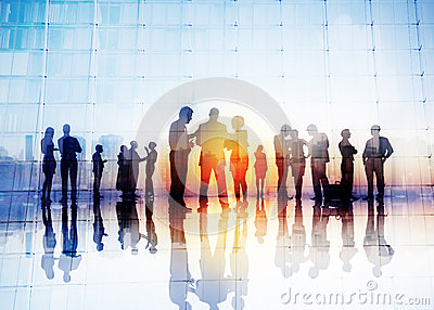 Silhouettes of Business People Discussing Outdoors