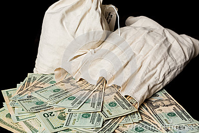 Many US dollar bills or notes with money bags