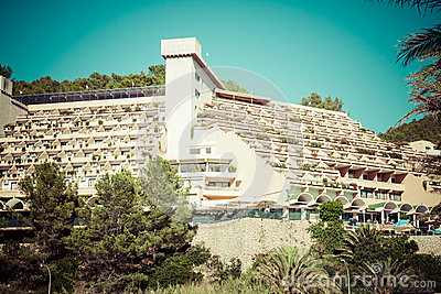 Holiday apartment building and sun terrace in Ibiza island, Spai