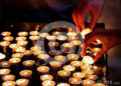 Lighting candles in a church
