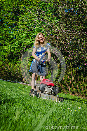 Woman and fuel grass cutting machine garden