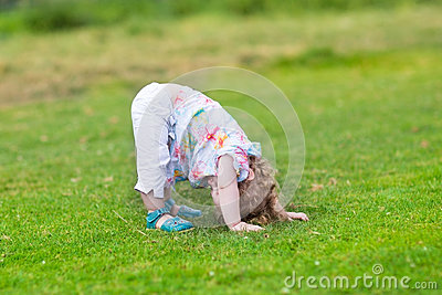 Adorable funny baby girl with her head down