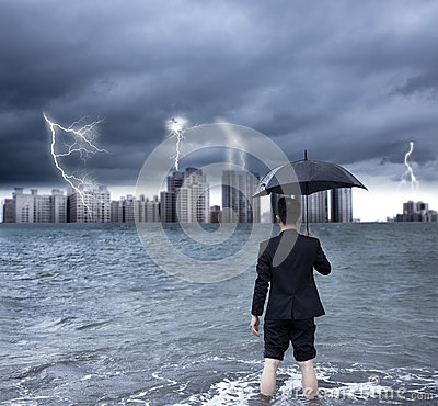 Business man holding an umbrella with thundershower
