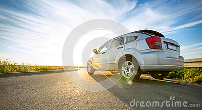 Car on road over sunny day