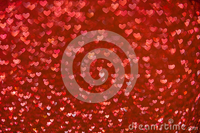 Defocused abstract red hearts light background