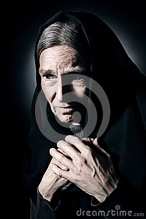 Lonely old woman in mourn and sorrow