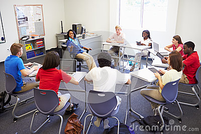 High School Students Taking Part In Group Discussi