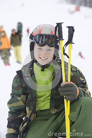 Portrait of young boy with ski gear