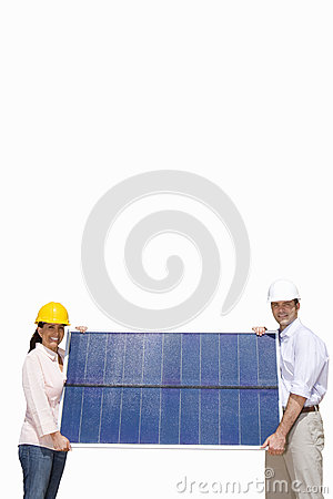 Man and woman in hard hats holding solar panel, cut out