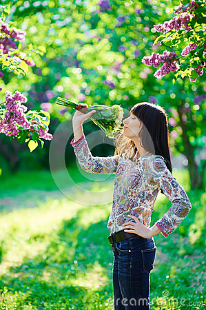 Young beautiful smiling woman smells small bouquet
