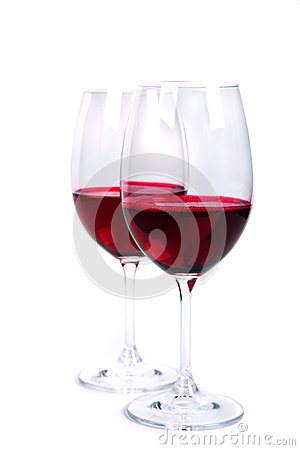 Two glass of red wine on a white background