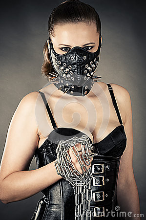 Beautiful woman in a mask with a chain