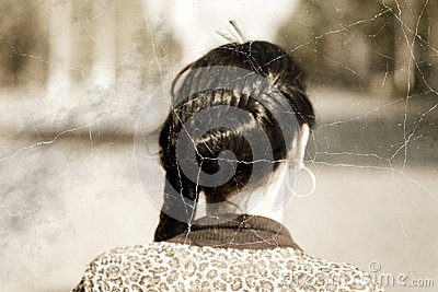 Old photo stylized headshot of a braided brunette women from back