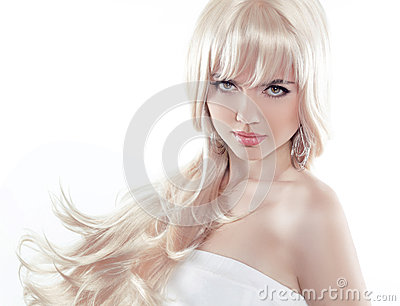 Beautiful young woman with long blond hair. Pretty model poses a