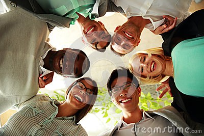 Happy business people with their heads together