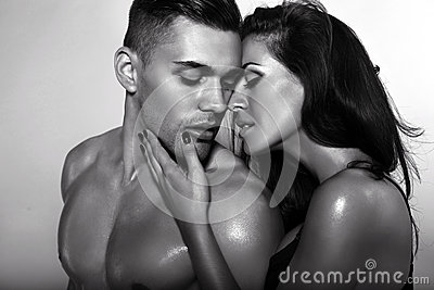 Black and white photo of sexy impassioned couple