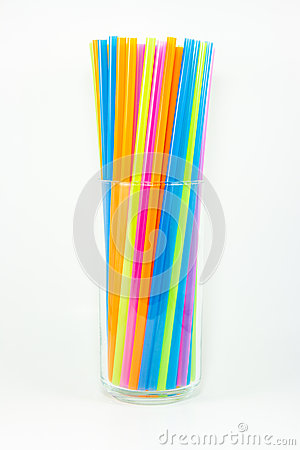 Colorful drinking straws in glass  on white background