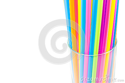 Drinking straws in glass isolated on white background