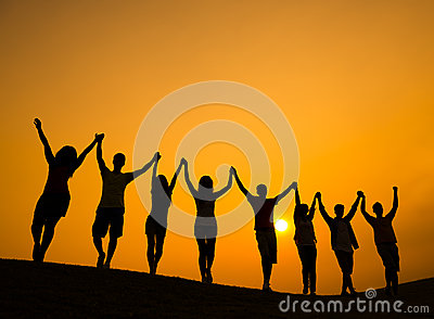 Group of Teenagers Holding Hands and Celebrate in Back Lit