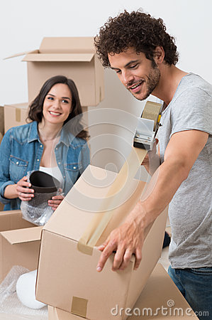 Man Packing Box With Sellotape