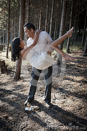 Young beautiful Indian couple dancing in forest