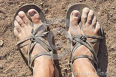 Dirty feet in sandals
