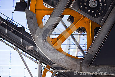 Industrial Linkage with orange trams flywheel with protective me
