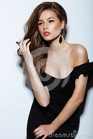 Individuality. Thoughtful Elegant Lady in Black Prom Dress