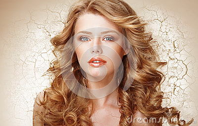Recovery Concept. Woman with Curly Hair over Cracked Dried Wall (Earth)