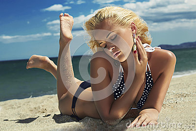 Beautiful woman on the beach.Blond Sexy girl in bikini. summer holidays