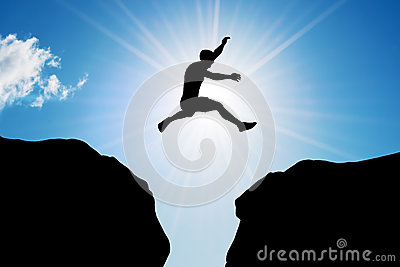 Man jumping over precipice. Risk, challenge, success.
