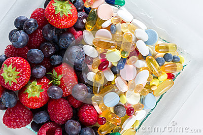 Healthy lifestyle, diet concept, Fruit and pills, vitamin supplements with on white background.