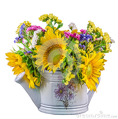 Yellow sunflowers and colored wild flowers in a white sprinkler, close up