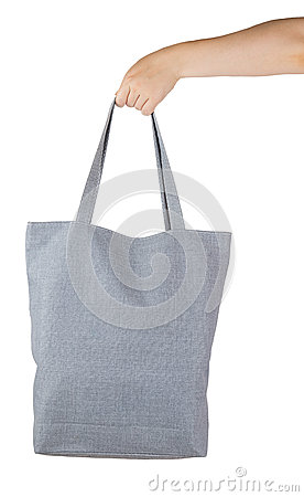 Female hand holding a gray textile shopping bag