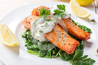 Healthy Salmon Steak on bed of spinach
