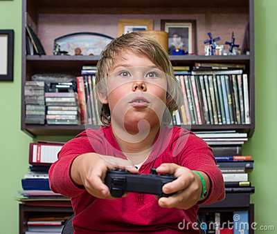 Boy   playing a video game console.