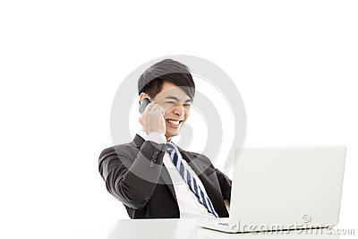Smiling business man talking happily by smart phone