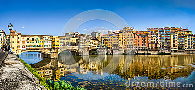 Panoramic view of Ponte Vecchio with river Arno at sunset, Florence, Italy