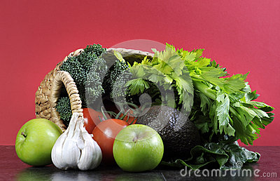 Healthy diet health foods with shopping basket full of vegetables