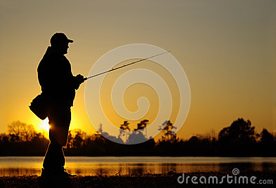 Lure fishing. fisherman fishing at sunset