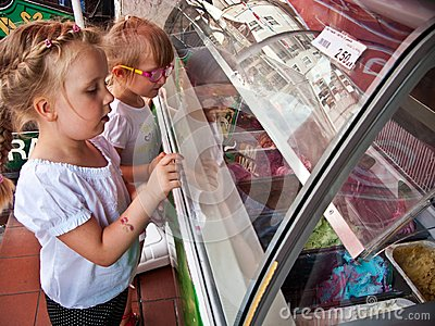 Girls choosing ice cream flavour