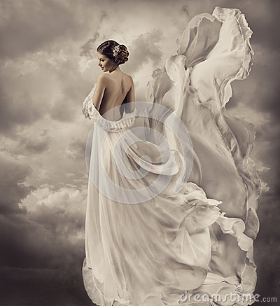 Woman dress, artistic white blowing gown, waving a
