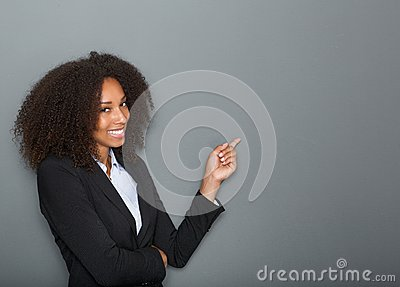 Friendly business woman pointing finger