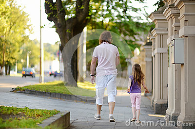 Father and daughter having a walk