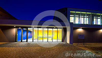 Modern gym building at night