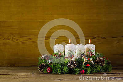 Advent wreath or crown with two burning white candles.